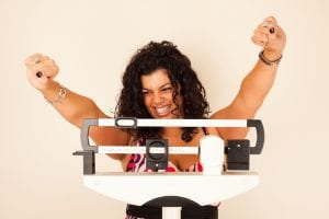 Girl celebrating Lap Band Surgery Weight Loss